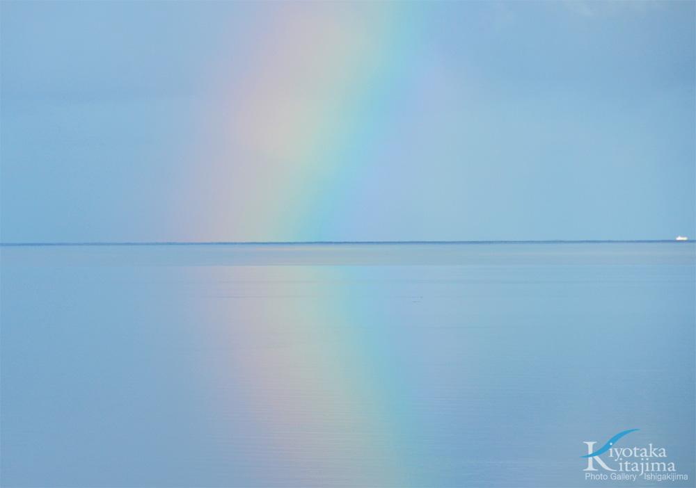 海 写真 朝の虹