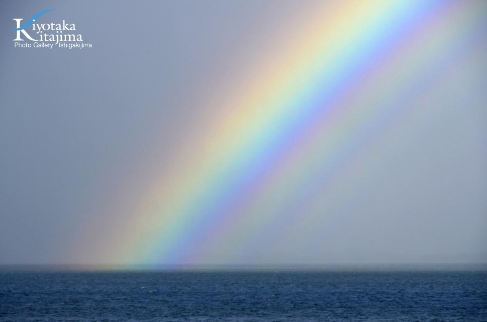 海 写真 正月の虹